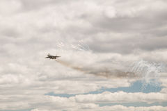 Military aircraft fighter plane performs a maneuver Stock Photo