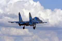 Military fighter su-27 Flanker on blue sky. The Sukhoi Su-27 (Russian: Сухой Су-27) (NATO reporting name: Flanker) is a twin-engine supermanoeuverable Stock Photos