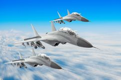 Military fighters jet three group aircraft at high speed, flying high in the sky. Military fighters jet three group aircraft at high speed, flying high in the Stock Photos