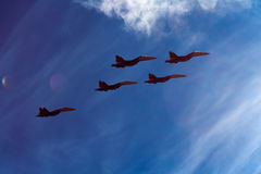 Military fighters su-27. In blue sky Stock Photos