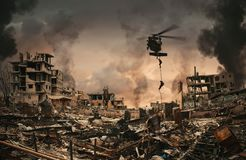 Military Forces between smoke and ruins royalty free stock image