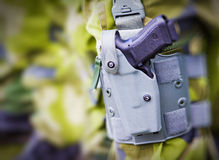 Military Funding. Closeup of a military hand-held pistol in holster Royalty Free Stock Images