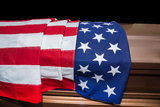 Military funeral casket. Casket draped with United States of American Flag Royalty Free Stock Image