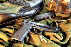 Military Gear. Close up of military gear and 9mm pistol Royalty Free Stock Image