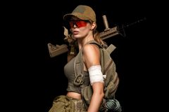 Military girl with automatic rifle. Dooms day royalty free stock image