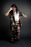 Military girl dancing. Against dark background Stock Image