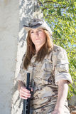 Military girl. With her gun Stock Image