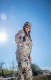Military girl. Spanish military girl pointing his gun Stock Images
