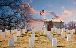 Military Graves Up Hill To Flag At Dusk Stock Image