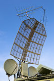 Military green antenna on transmitter Stock Photo