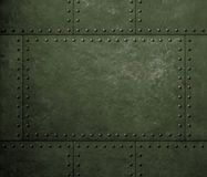 Military green metal armor background with rivets. Metal green armor background with rivets stock photo