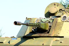 Military gun-turret. Gun-turret on a green heavy armored military vehicle close up shot royalty free stock photo