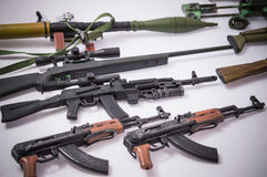 Authentic Military guns toy white backgrounds Stock Photography