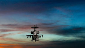 Military gunship flying with dramatic sky Royalty Free Stock Photography