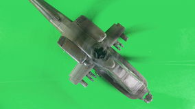 Military gunship flying on greenscreen stock footage