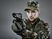 Military guy shooting Royalty Free Stock Photos