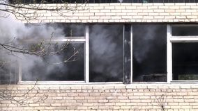 Military hand grenade explosion on background of destroyed house.