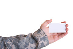 Military hand holding business card Royalty Free Stock Images