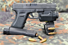 Military handgun with laser/light-module Stock Images