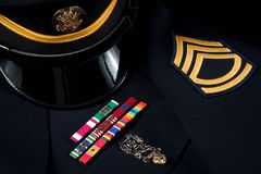 Military Hat and Dress Uniform with Decorations stock image
