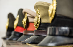 Military Hats. Perspective view of Military Hats in a thai railway station Stock Images
