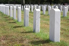 Military Headstones. Headstones mark the graves of veterans and their loved ones at Barrancas National Cemetery, Naval Air Station, Pensacola, Florida royalty free stock photo