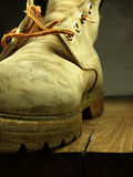 Military, heavy shoe on the edge. Royalty Free Stock Photos
