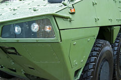 Military heavy vehicle. Detail of front and wheels stock image