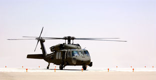 A military helicopter. (Black Hawk) on a helipad outdoor stock images