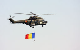 Military helicopter. In exercise fly with flag Stock Photos