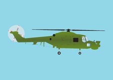 Military Helicopter. A Military Attack Helicopter in Olive Green Camouflage in Flight Stock Photo