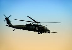 Military helicopter. US Army helicopter in early morning stock image