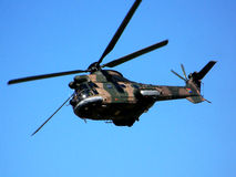 Military helicopter. A South African Air Force helicopter flying over the Port Elizabeth Airport Royalty Free Stock Photos