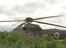 Military Helicopter. A military helicopter parked in a field Royalty Free Stock Photos