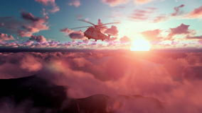 Military Helicopter above clouds at sunset stock video footage