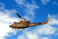 Military helicopter Augusta Bell AB-212, flying low Stock Photos