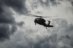 Military Helicopter. A military helicopter coming in for landing Stock Photo