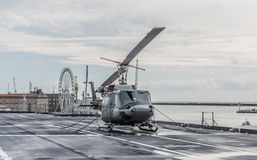 Military helicopter on the deck of an aircraft carrier. Cavour is an Italian aircraft carrier launched in 2004. It is the flagship of the Italian Navy. The ship royalty free stock photography