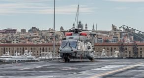 Military helicopter on the deck of an aircraft carrier. Cavour is an Italian aircraft carrier launched in 2004. It is the flagship of the Italian Navy. The ship royalty free stock photos