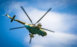 Military helicopter. A military helicopter flies in the sky Stock Photo