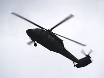 Military Helicopter in flight Stock Images