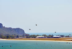 Military helicopter fly to the camp at the beach Stock Image