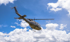 Military helicopter flying Stock Images
