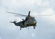 Military Helicopter Hovering. A large military helicopter hovering in mid-air.  This is a Sea King helicopter from the Royal Navy Royalty Free Stock Image