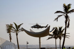 Military Helicopter Landing on Beachfront Stock Photo