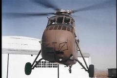 Military helicopter landing on helipad stock footage