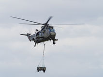 Military helicopter lifting load Royalty Free Stock Images