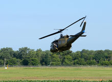 Military helicopter over field Stock Photo