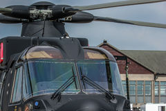 Military Helicopter. A photo close up of a Military helicopter used by the British Royal Navy on a mild english afternoon. Made possible by yeovilton airshow Royalty Free Stock Photo