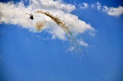 Military helicopter releasing flares Royalty Free Stock Photo